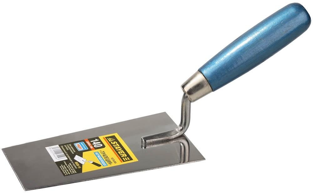 Кельма STAYER PROFI с деревянной рукояткой (форма трапеция / 140 мм)Шпатели, кельмы, гладилки<br>Универсальная кельма STAYER PROFI с деревянной рукояткой (форма трапеция / 140 мм) отличается широкими эксплуатационными возможностями. Область ее применения охватывает различные этапы строительных/ремонтных работ. Благодаря трапециевидной форме рабочего полотна, инструмент используется для отмеривания (дозировки) сыпучих материалов, приготовления растворов вручную, нанесения полученных смесей на основание с последующим выравниванием, подрезание излишков. Например, кельма применяется при<br>